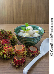 Peeled rambutan stuffed with pineapple in syrup.