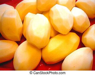 peeled raw potatoes