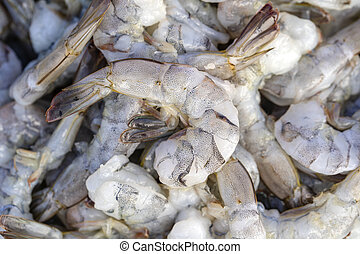 Peeled sea shrimp at street market in Thailand. Seafood concept.