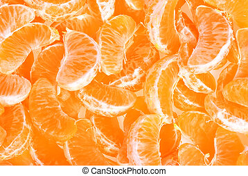 Peeled tangerine or mandarin fruit as background