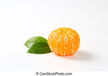 peeled tangerine with leaves