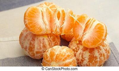 peeled tangerines rotate