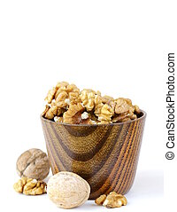 peeled walnuts in a wooden bowl
