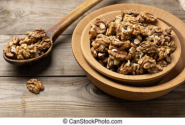 peeled walnuts in a wooden plate on the table