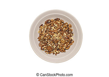 Plate with walnuts on a white background top view.
