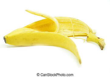 Peeled yellow banana skin on white background, Selective...
