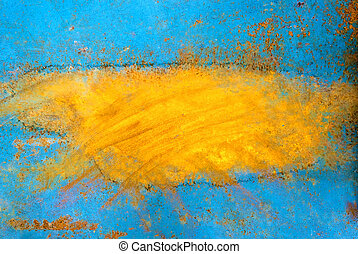 Peeling blue orange paint on a metal surface