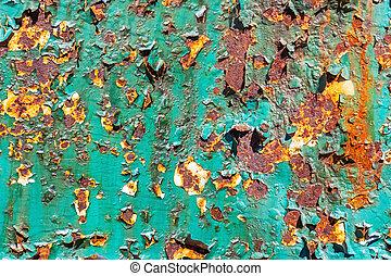 Peeling green paint.