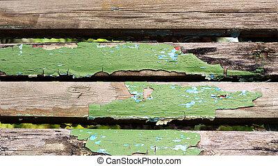 Peeling green paint on old wood