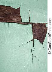 peeling green paint on wood