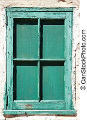 Peeling green painted window