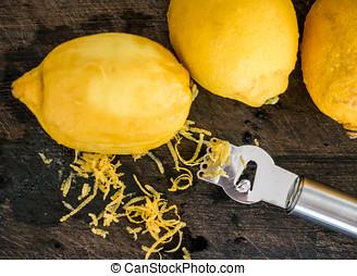 Peeling lemon rind to add zest to cook
