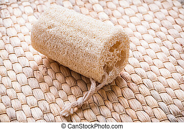 Peeling loofah on wicker mat healthcare concept