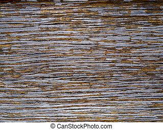 Peeling paint on old wood.