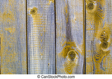 Peeling paint on old wooden rustic material on the wall.