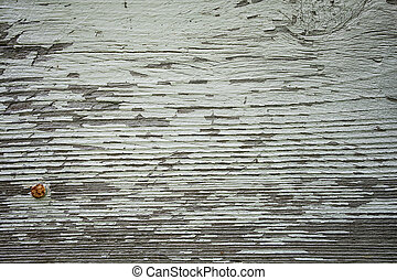 peeling paint on rustic wood