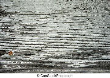 peeling paint on rustic wood