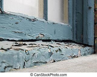 Peeling paint on window sill - Closeup of an old window sill...