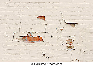 background with a red brick wall revealed through the peeling paint
