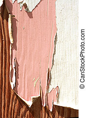 Peeling paint over old wooden texture background