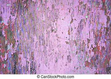 Peeling pink paint on wooden background