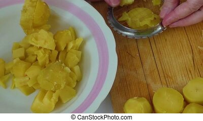 Peeling potatoes - Preparing dinner: Hands peeling potatoes