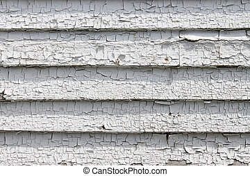 Peeling white paint - Close-up of peeling dried out white...