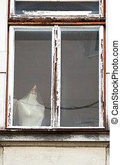 peeling wood window - peeling wooden windows, symbol of...