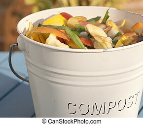 detail of a compost bucket containint vegetable peelings