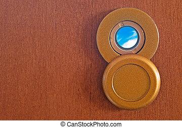 peephole and sky - peephole on a wooden door