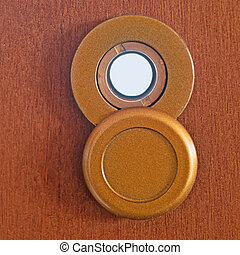 peephole and white - peephole on a wooden door
