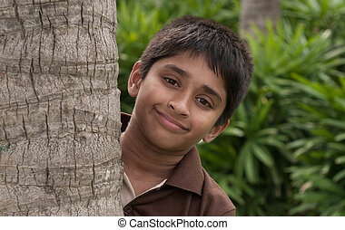 Peeping - An handsome Indian kid peeping thru the trunk