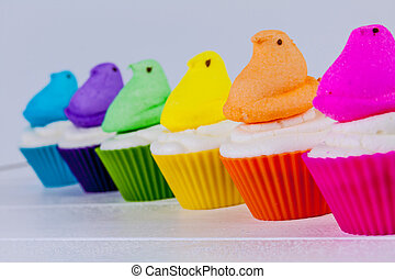 Peeps Easter Cupcakes - Brightly colored Peeps marshmallow...