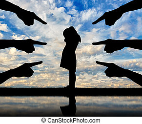 Peers' hands show with their fingers a lonely, frightened child girl who is crying. Conceptual image of bullying children