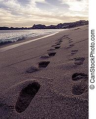 pegadas, areia