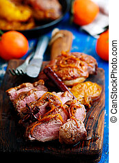 peking duck breast clementine spices. style rustic