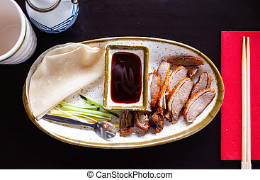 Peking duck with sauce and chinese pancakes