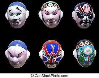 Peking Opera Mask on the Black Background