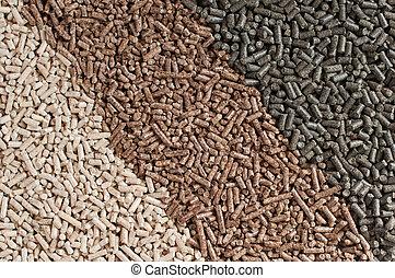 Pellets- biomass - Three  kind of pellets in a row