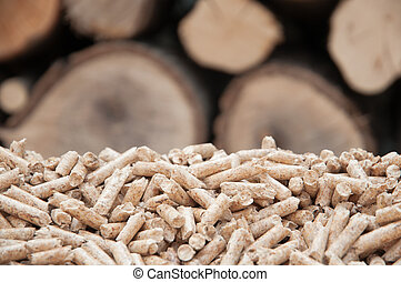 Pellets- Biomass - Pine pellets- selective focus on the heap