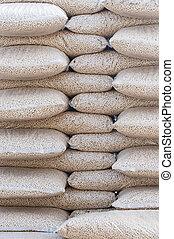 Pellets- Biomass - Pine pellets- stack of sacks- stock photo