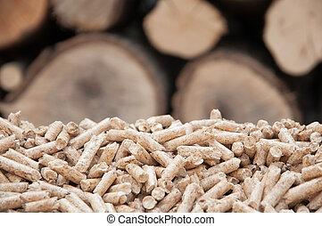 Pellets- Biomass - Pine pellets- selective focus on the heap