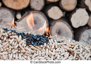 Pellets- Biomass - Pine pellets in flames- stock image