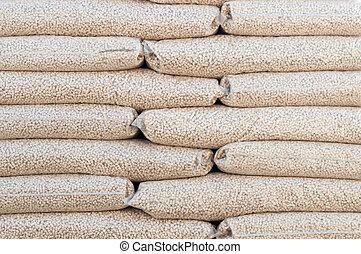 Pellets- Biomass - Heap of stacks of Pine pellets - stock...
