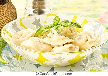 pelmeni - delicious freshly cooked ravioli on a plate