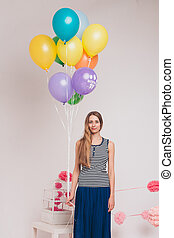 pelotas, coloreado, ella, blanco, fondo., esperar, estudio, atractivo, birthday., retrato, niña, rubio