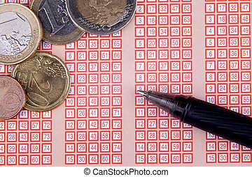 pen and bingo lotto lottery ticket with euro money and numbers