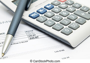 Pen, calculator and bill