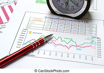 pen clock and business graph