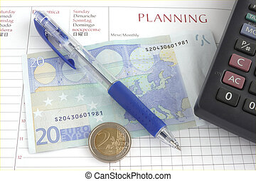 pen coins and calculator